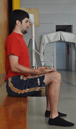 autoelongacion de la columna vertebral sentado